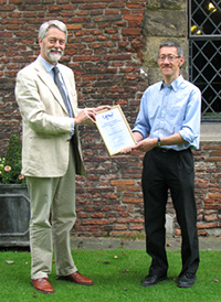 Professor Mike Mendl (right) receives the UFAW Medal from Dr Robert Hubrecht, UFAW Chief Executive, at the UFAW conference held at the York Merchant Adventurers' Hall on 26th June
